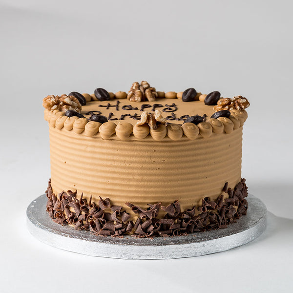 Photograph of a Coffee Buttercream Celebration Cake with decoration available to order at ChocoCake