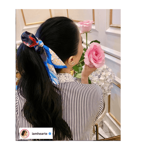 Heart Evangelista using a silk scarf as a hair scrunchie