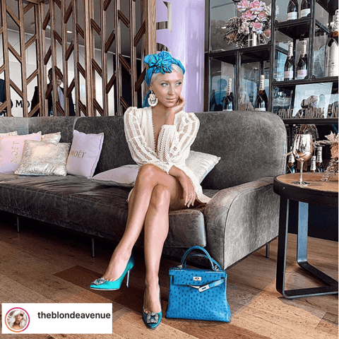@theblondeavenue   has turned her silk scarf into an elegant head piece