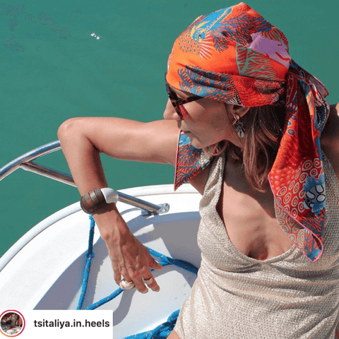 @tsitaliya.in.heels takes the scarf head piece on a boat trip.