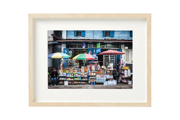 Horizontal photo of a Convenience Store in Luang Prabang, Laos, shown in a boxed frame.