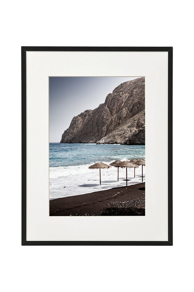 Vertical photo of Black Sand Beach in Santorini shown in a normal frame.