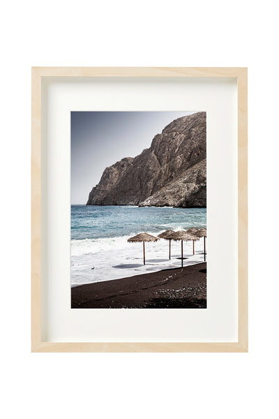 Vertical photo of Black Sand Beach in Santorini shown in a boxed frame.