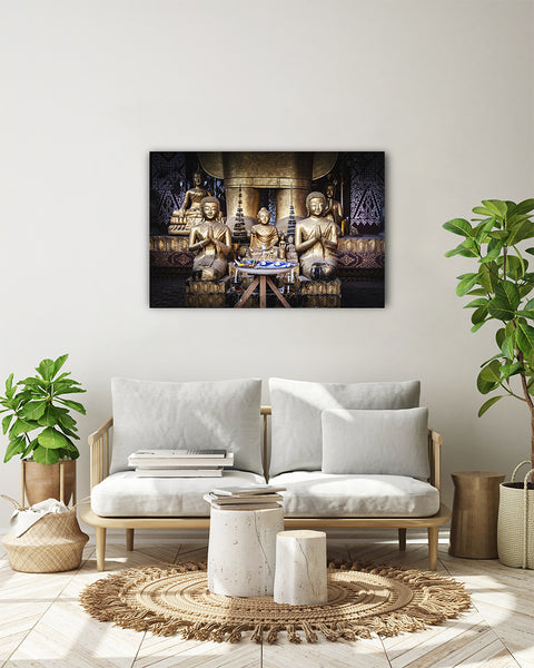 Horizontal photo of Buddha Shrines in a temple complex in Luang Prabang, Laos, shown on a white wall in a modern living room.