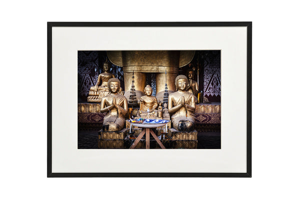 Horizontal photo of Buddha Shrines in a temple complex in Luang Prabang, Laos, shown in a normal frame.