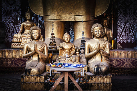 Horizontal photo of Buddha Shrines in a temple complex in Luang Prabang, Laos.