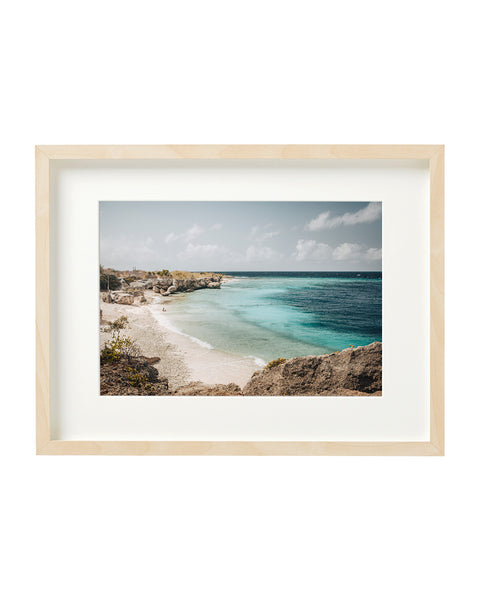 Horizontal photo of Director's Bay beach, Curaçao. Horizontal photo in a boxed frame.
