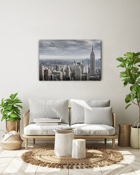 Empre State Building seen from the top of Rockefeller Centre, New York City. Horizontal photo shown on a white wall, in a modern living room.