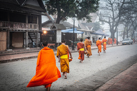 Monks crossing the street in Luang Prabang.