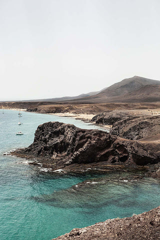 Vertical photo of the Playa de Papagayo, in Lanzarote, Spain.