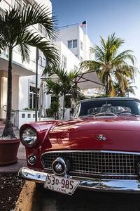 Vintage red Oldtimer car, parked in front of a hotel in Ocean Drive.