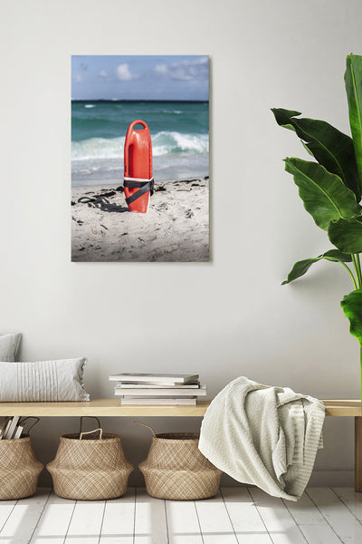Rescue buoy in Miami Beach. Vertical photo shown on a white wall, in a modern interior.
