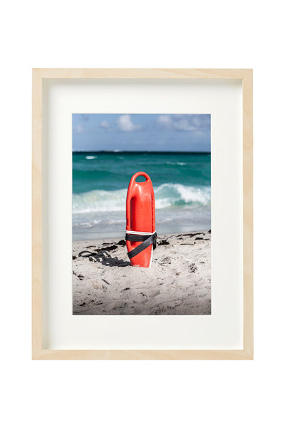 Rescue buoy in Miami Beach. Vertical photo shown in a boxed frame.