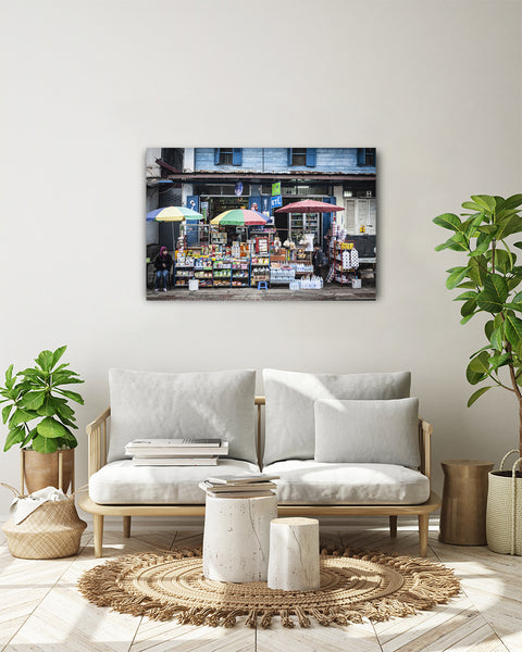 Horizontal photo of a Convenience Store in Luang Prabang, Laos, shown on a white wall in a modern interior.