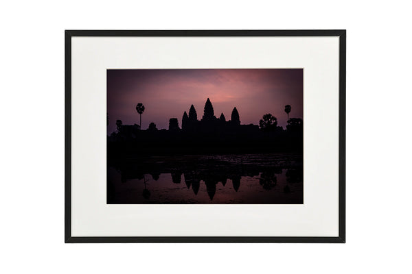 Sunrise at the majestic temple complex of Angkor Wat, Siem Reap, Cambodia. Horizontal photo shown in a normal frame.