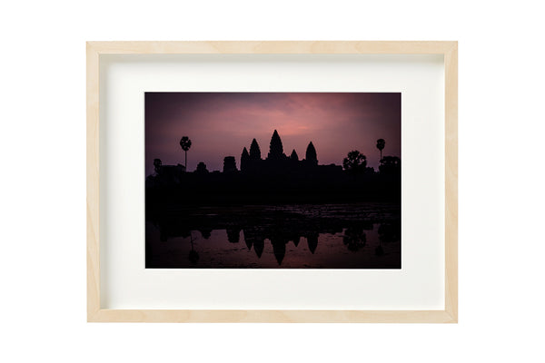 Sunrise at the majestic temple complex of Angkor Wat, Siem Reap, Cambodia. Horizontal photo shown in a boxed frame.