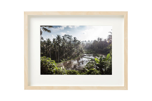 Sunset over the sawas. Horizontal photo shown in a boxed frame.