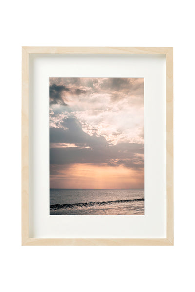 Photo of a sunset in a Beach, in Bali, shown in a vertical boxed frame.