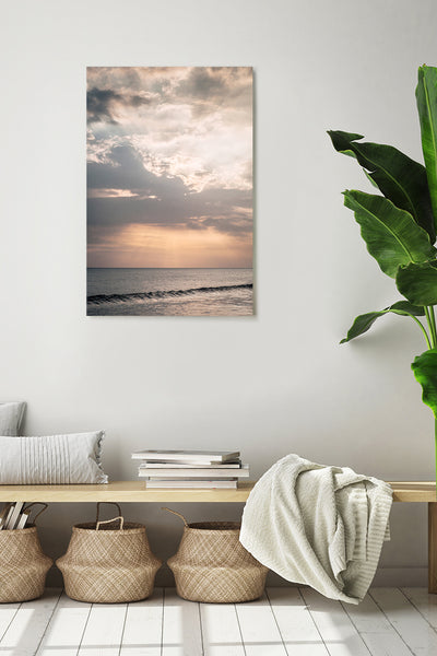 Photo of a sunset in a Beach, in Bali. Vertical photo shown on a white wall in a modern interior.