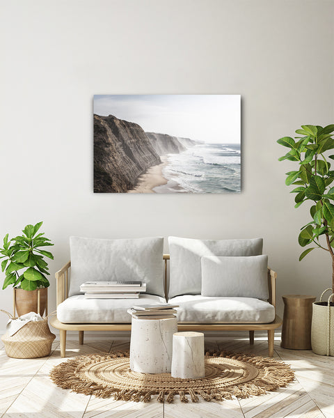 View from Praia do Magoito towards Cabo da Roca. Horizontal photo shown on a white wall, in a modern living room.