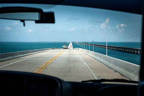 Photo taken from inside a car, driving through the famous Seven Miles Bridge.