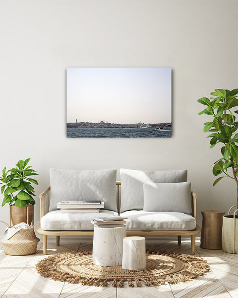 Horizontal view over the Golden Horn and old city centre from the Bosporus canal, Istanbul, Turkey. Photo shown on a white wall in a modern living room.
