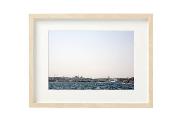 View over the Golden Horn and old city centre from the Bosporus canal, Istanbul, Turkey. Photo shown in a boxed frame.