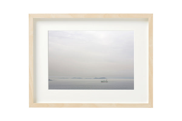 View to the Prince's Islands, from the Bosporus canal. Horizontal photo shown in a boxed frame.