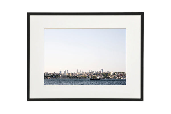 View from the Bosporus canal to the modern business district of Istanbul. Horizontal photo shown in a modern frame.