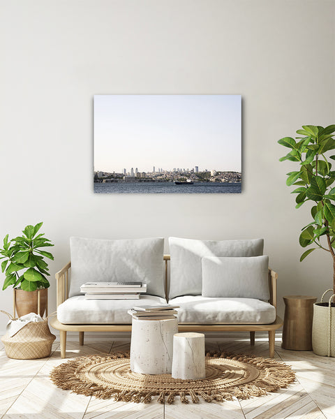 View from the Bosporus canal to the modern business district of Istanbul. Horizontal photo shown on a white wall in a modern living room.