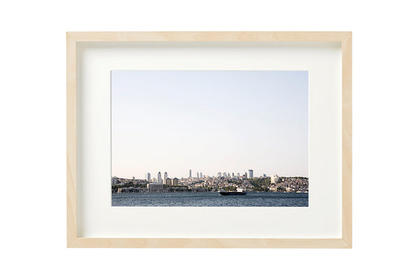 View from the Bosporus canal to the modern business district of Istanbul. Horizontal photo shown in a boxed frame.