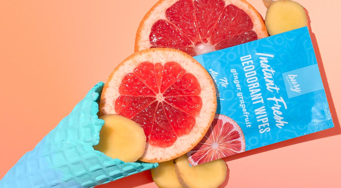 A Busy Beauty Deodorant Wipe surrounded by slices of grapefruit, and a blue ice cream waffle