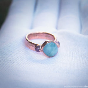 copper ring with aquamarine and rubies