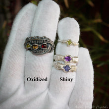 Load image into Gallery viewer, heady wire wrapped rings on hand with glove