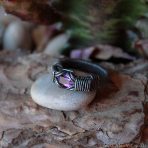 wire wrapped black ring with faceted amethyst