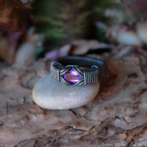 wire wrapped black ring with stone