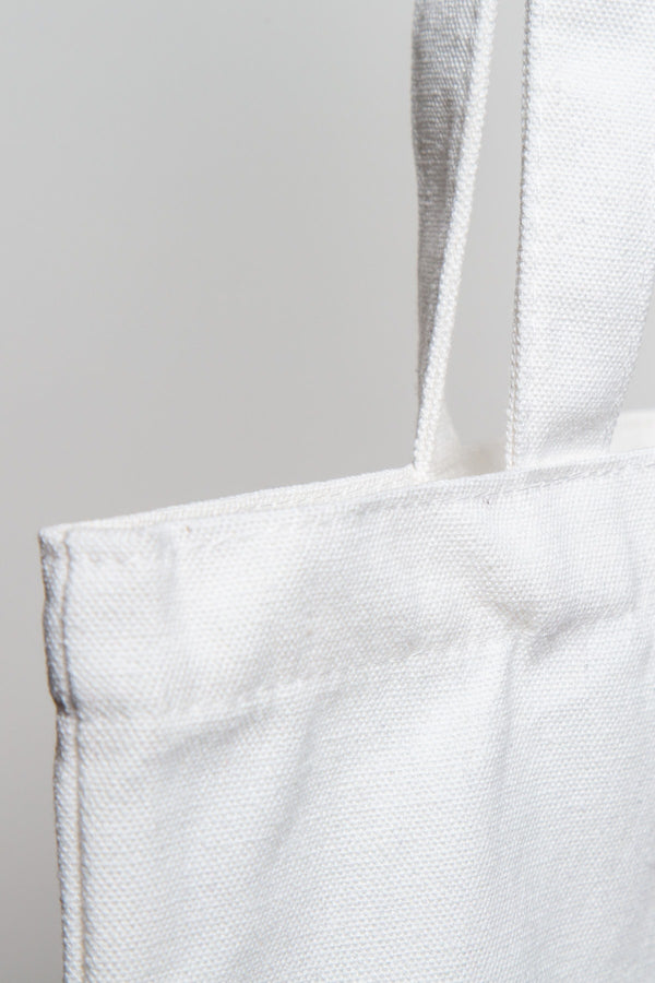 nude branded tote bag