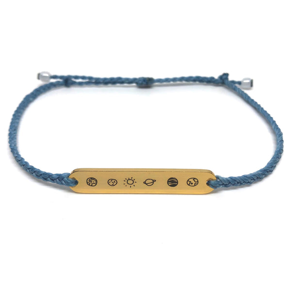 image of galaxy sky blue bracelet with gold plated bar charm