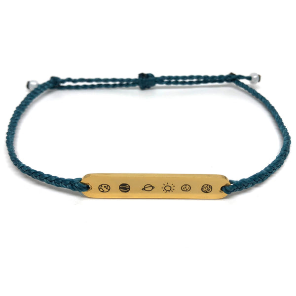 image of galaxy teal bracelet with gold plated bar charm