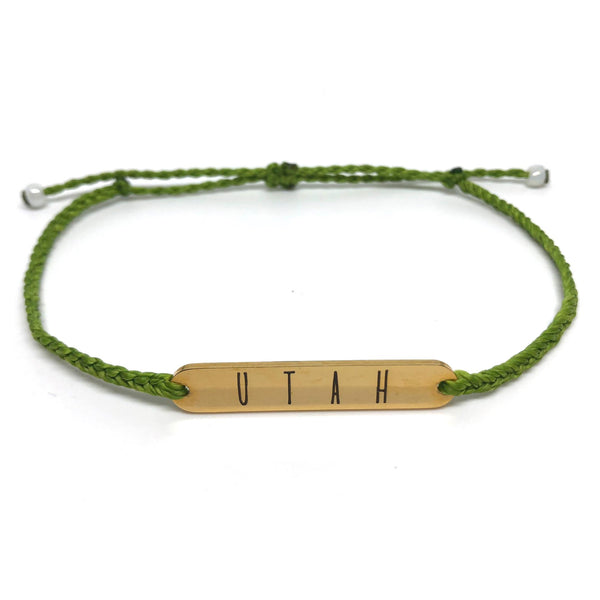 image of Utah grass green bracelet with gold plated bar charm