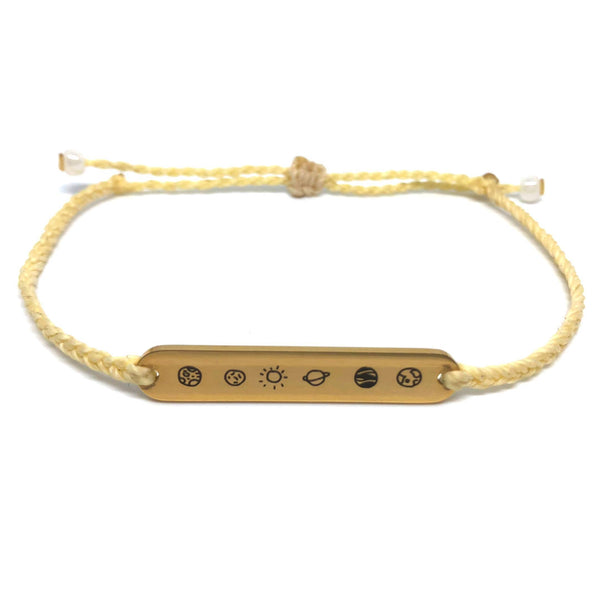 image of galaxy pastel yellow bracelet with gold plated bar charm