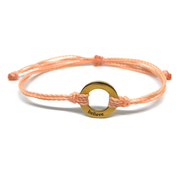 image of Believe peach bracelet with gold plated circle charm