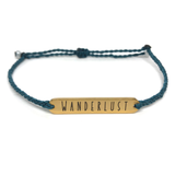 image of wanderlust teal bracelet with gold plated bar charm