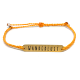 image of wanderlust mustard yellow bracelet with gold plated bar charm