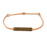 image of wanderlust peach bracelet with gold plated bar charm