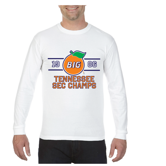 white long sleeve shirt with a large orange saying big in the middle of it and 1986 flanking the sides, below is Tennessee SEC Champs, TriStar Tees