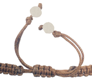 All natural Hand carved Shell Tagua charm on a hand woven cotton bracelet by Tu y Yo (brown)