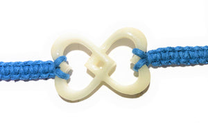 All natural Hand carved Interlocked Hearts Tagua charm on a hand woven cotton bracelet by Tu y Yo