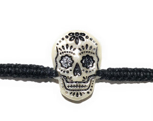All natural Hand carved Skull Tagua charm on a hand woven cotton bracelet by Tu y Yo