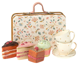 cake set in suitcase